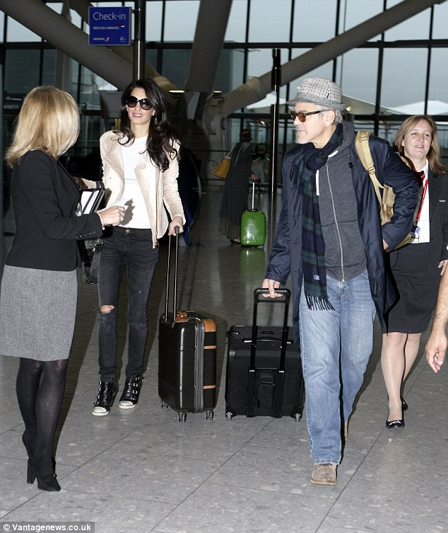George and Amal Clooney spotted at Heathrow 238BC8E700000578-0-image-59_1417092645908