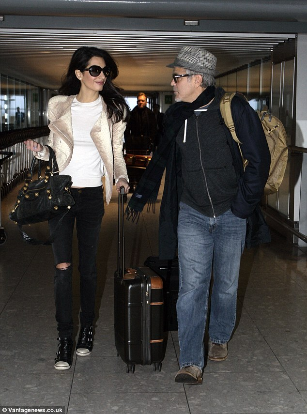 George and Amal Clooney spotted at Heathrow 238BC8F900000578-2851739-image-60_1417093380193