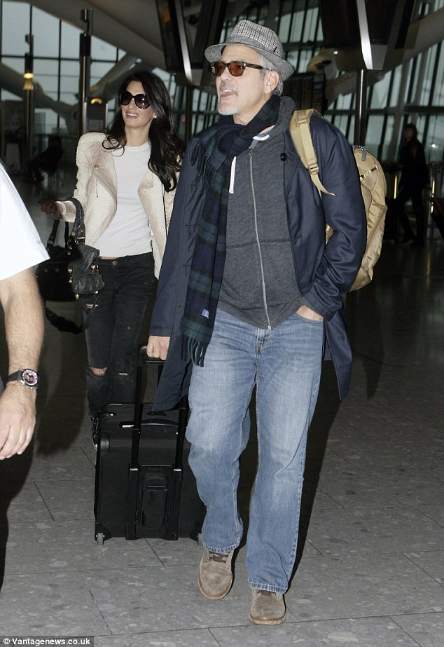 George and Amal Clooney spotted at Heathrow 238BC92400000578-2851739-image-61_1417093434070