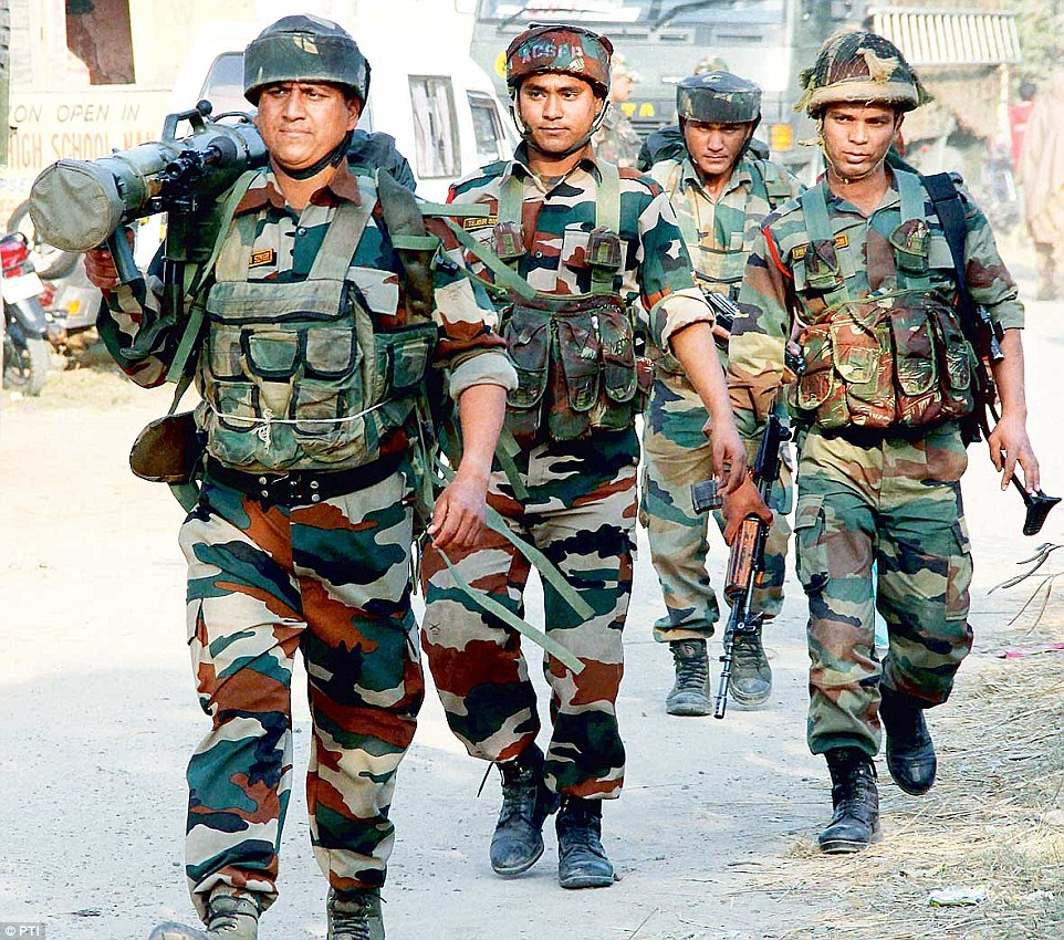 inde 238FDE1D00000578-2852285-Response_A_jawan_wields_a_rocket_launcher_as_he_moves_towards_th-37_1417149592435