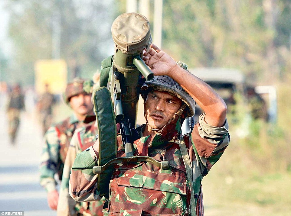 inde 238FDE3100000578-2852285-Violence_Another_soldier_carries_a_rocket_launcher_near_the_site-38_1417149592443