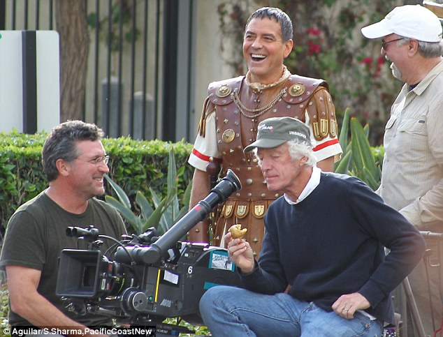 Hail Caesar filming in L A - George Clooney on the set 23C056A500000578-2861698-Comfortable_customer_The_actor_seemed_to_be_having_a_good_time_o-a-43_1417750076931
