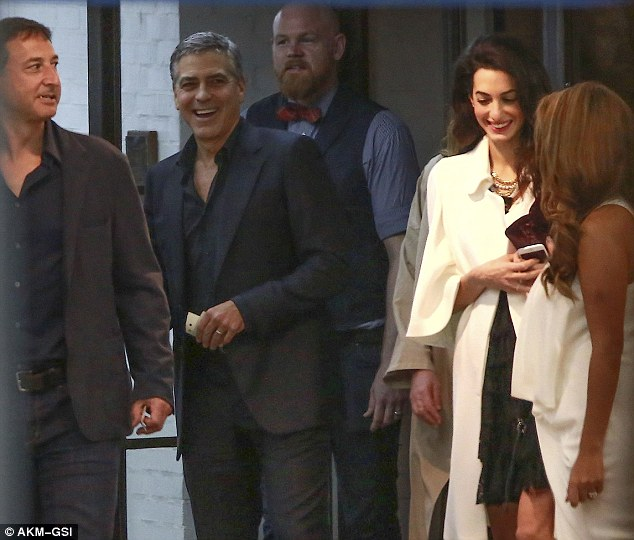 George and Amal Clooney's Date Night at Soho House in West Hollywood 23E2197B00000578-2865724-George_appeared_to_be_the_life_and_soul_of_the_group_as_he_got_e-m-43_1418058861140
