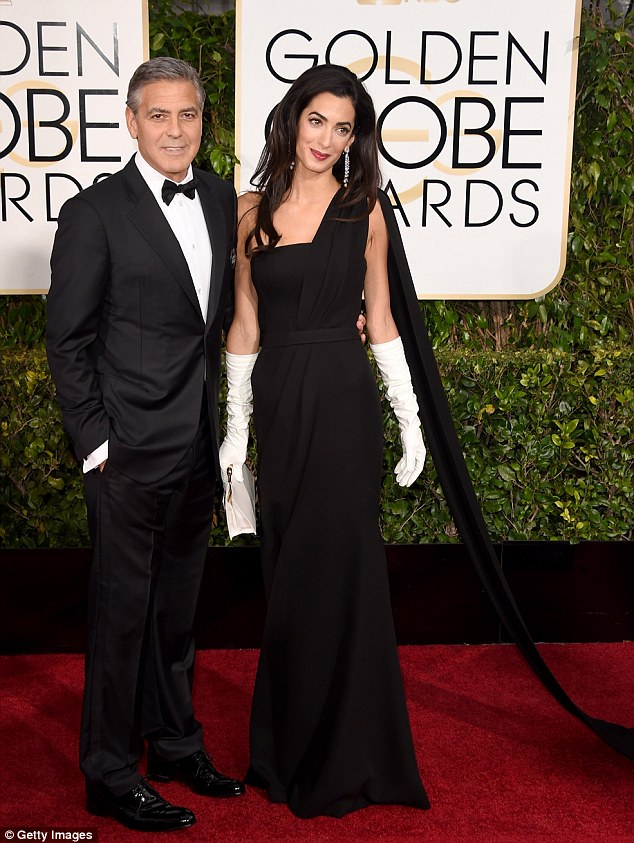 George Clooney at the Golden Globes January 2015 - Page 2 249B6FFF00000578-2905892-The_newlyweds_George_and_Amal_Clooney_made_their_debut_Golden_Gl-m-50_1421022817119