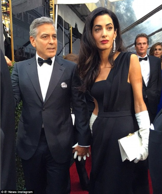 George Clooney at the Golden Globes January 2015 - Page 2 249B737400000578-2905892-image-a-81_1421025991872