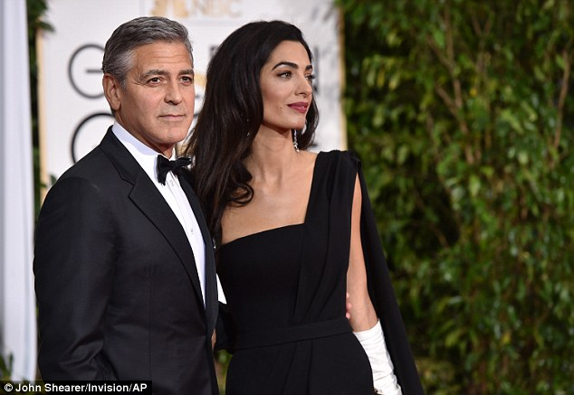 George Clooney at the Golden Globes January 2015 - Page 2 249B7B4800000578-2905892-image-a-92_1421028642329