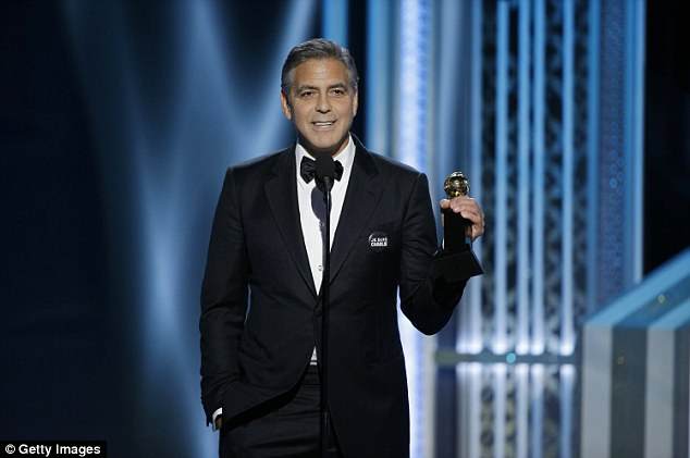 George Clooney at the Golden Globes January 2015 - Page 3 249D5B1100000578-2906190-Got_her_attention_However_as_soon_as_her_husband_of_four_months_-a-18_1421040279248