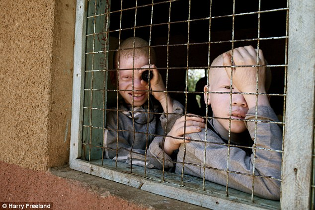 من هم الالبينوalbino؟واين يعيشون ؟ قصة «الألبينو» بالصور 24F5886800000578-2922243-Children_and_adults_are_kept_behind_high_walls_in_special_centre-a-7_1422286139563