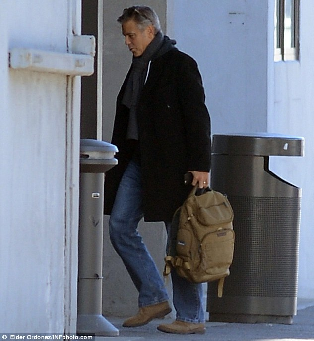 George Clooney arrives to set of Jodie Foster-directed movie Money Monster for his first day of filming 263A126400000578-2974921-Money_Monster_George_is_set_to_play_Lee_Gates_a_bombastic_televi-m-2_1425260282315