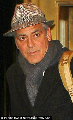 George Clooney exiting the Carlyle on Wednesday (March 4) in New York City. 26544DD600000578-2980399-image-m-31_1425527815806