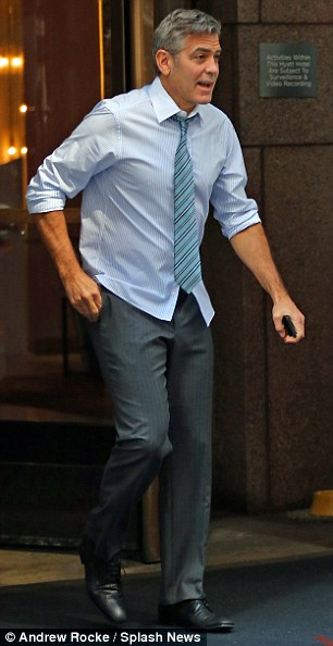 George Clooney on location: Money Monster NYC April 18, 2015 27B3F2DA00000578-3044926-image-m-84_1429375376886