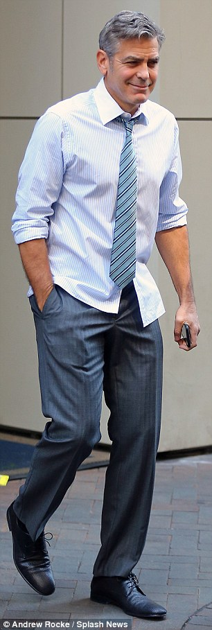 George Clooney on location: Money Monster NYC April 18, 2015 27B3F4F000000578-3044926-image-a-74_1429375267703