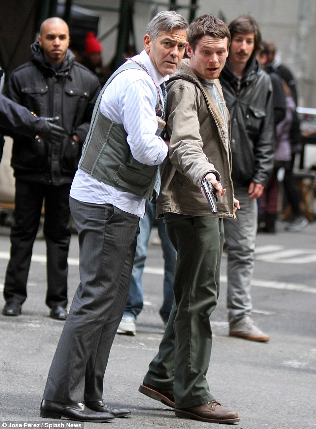 George Clooney Walking Around New York City In A Suicide Vest While Filming 'Money Monster' Friday, 24th April 2015 27F34A3200000578-3054400-image-m-54_1429899200946