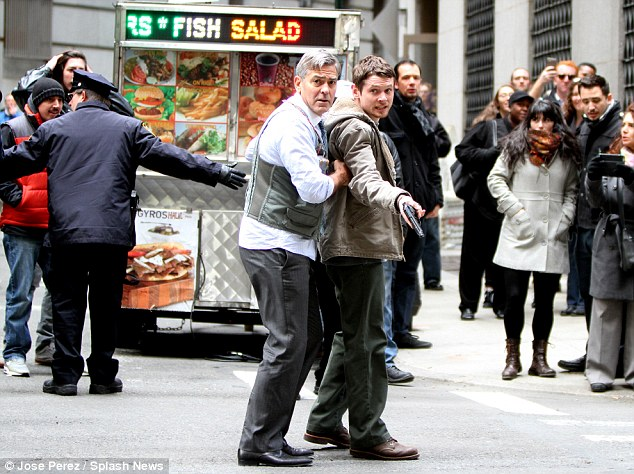 George Clooney Walking Around New York City In A Suicide Vest While Filming 'Money Monster' Friday, 24th April 2015 27F34A3E00000578-3054400-image-m-64_1429899925998