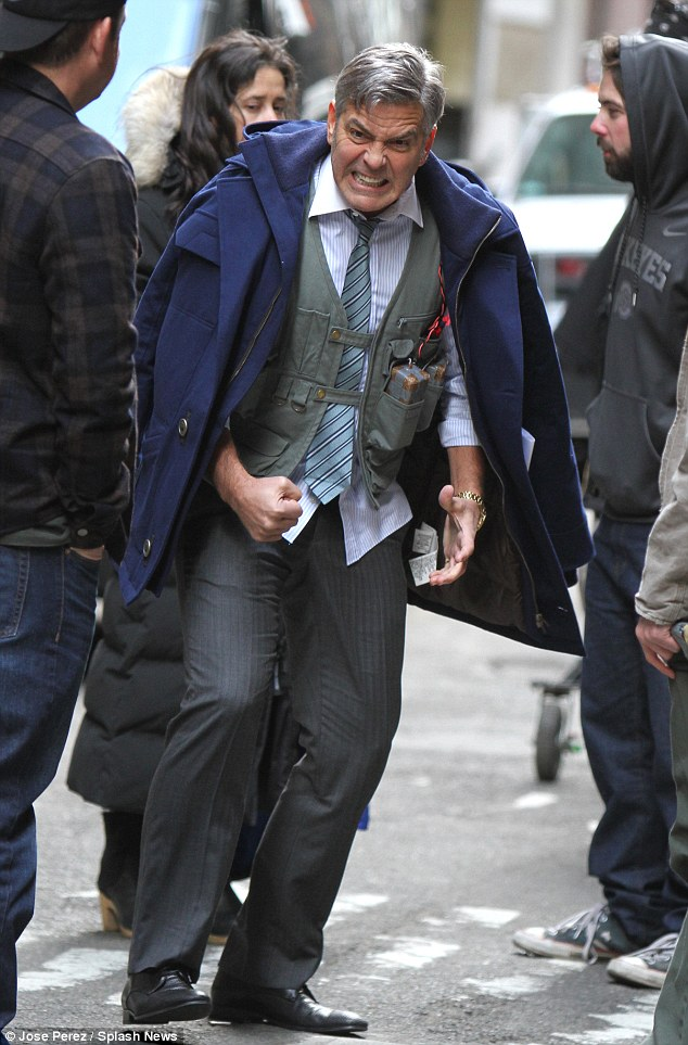 George Clooney Walking Around New York City In A Suicide Vest While Filming 'Money Monster' Friday, 24th April 2015 27F34A6C00000578-3054400-image-m-62_1429899423733