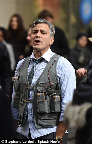 George Clooney Walking Around New York City In A Suicide Vest While Filming 'Money Monster' Friday, 24th April 2015 27F60BF100000578-3055163-image-a-100_1429963459829