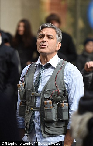 George Clooney Walking Around New York City In A Suicide Vest While Filming 'Money Monster' Friday, 24th April 2015 27F60C2100000578-3055163-image-m-107_1429963580379