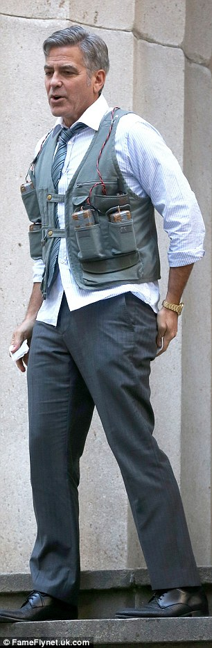 George Clooney Walking Around New York City In A Suicide Vest While Filming 'Money Monster' Friday, 24th April 2015 27F6D7E400000578-3055163-image-a-91_1429963350777