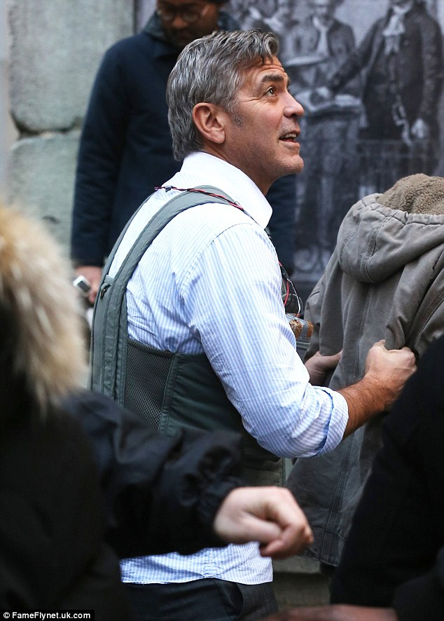 George Clooney Walking Around New York City In A Suicide Vest While Filming 'Money Monster' Friday, 24th April 2015 27F6D80100000578-3055163-image-a-93_1429963356679