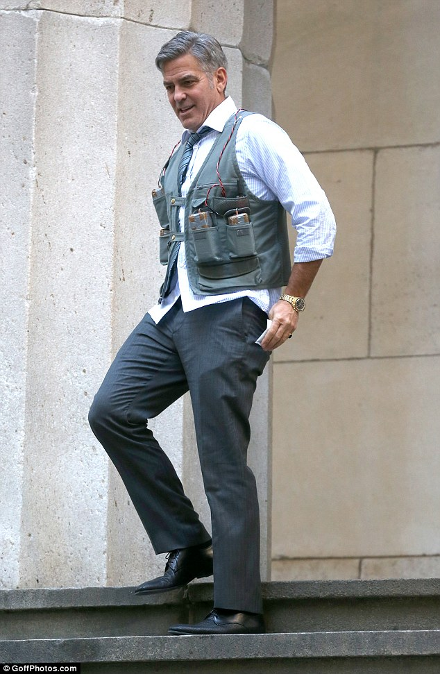 George Clooney Walking Around New York City In A Suicide Vest While Filming 'Money Monster' Friday, 24th April 2015 27F9462700000578-3055163-image-a-94_1429963361793