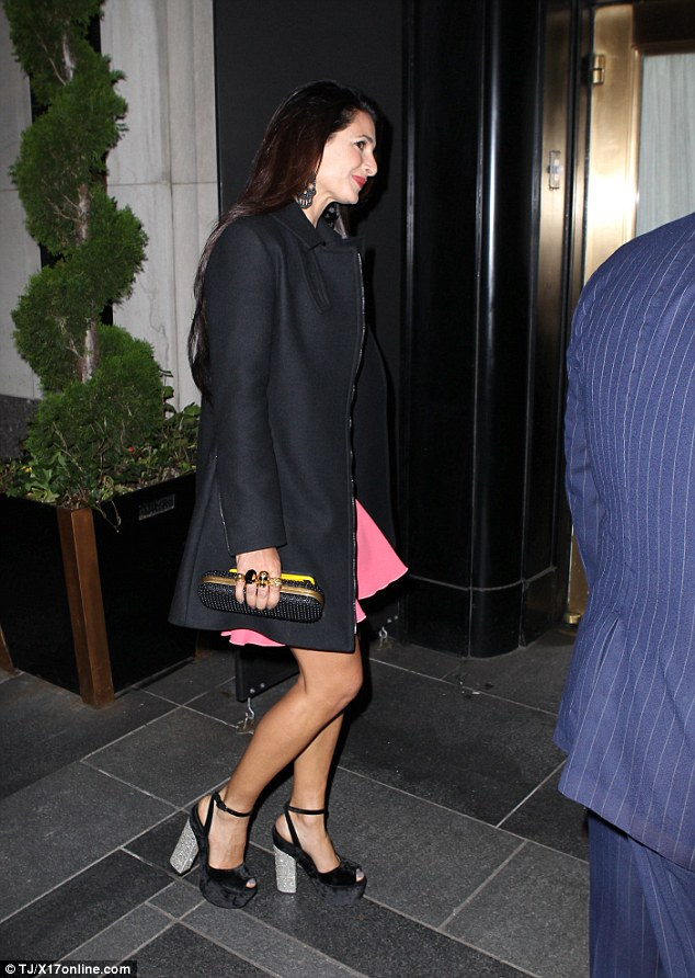 George Clooney is at his charming best as he heads out with his in-laws to celebrate glamorous sister-in-law Tala Alamuddin's birthday in New York 282F960B00000578-3063872-image-a-19_1430470082636