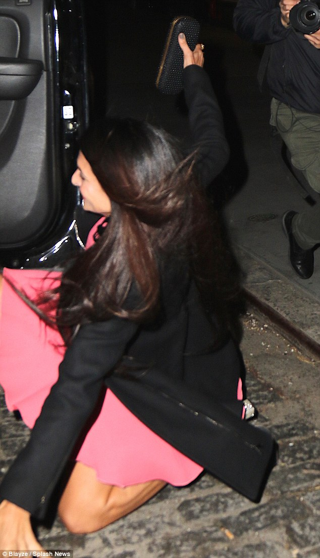 George Clooney is at his charming best as he heads out with his in-laws to celebrate glamorous sister-in-law Tala Alamuddin's birthday in New York 28348AB300000578-3063872-image-m-44_1430494607424