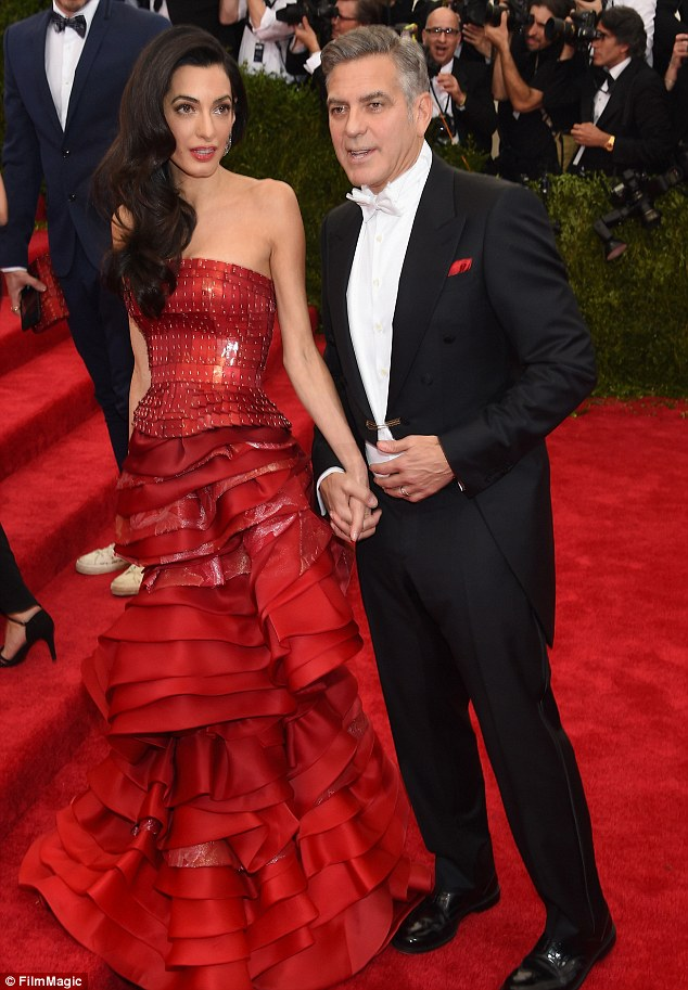 George Clooney at the Met Gala 4th May 2015 - Page 2 285035F800000578-3068128-Touchy_feely_The_actor_held_his_glamourous_wife_s_hand-m-83_1430787390523