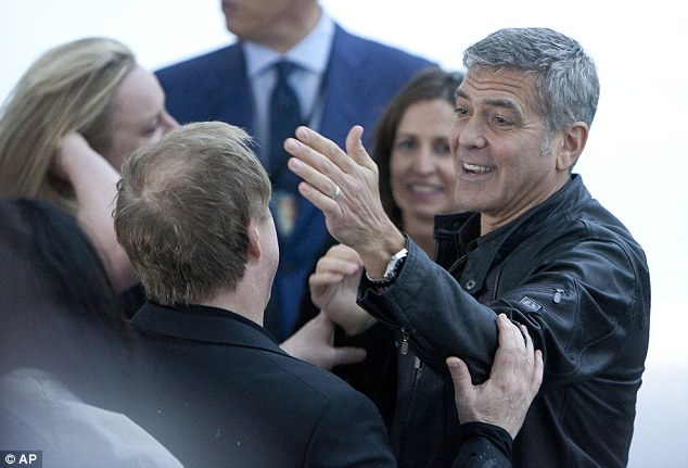 George at Valencia premiere of Tomorrowland May 19,  2015 28DEB60E00000578-0-Goofing_around_George_gets_playful_with_director_Brad-m-213_1432082357038