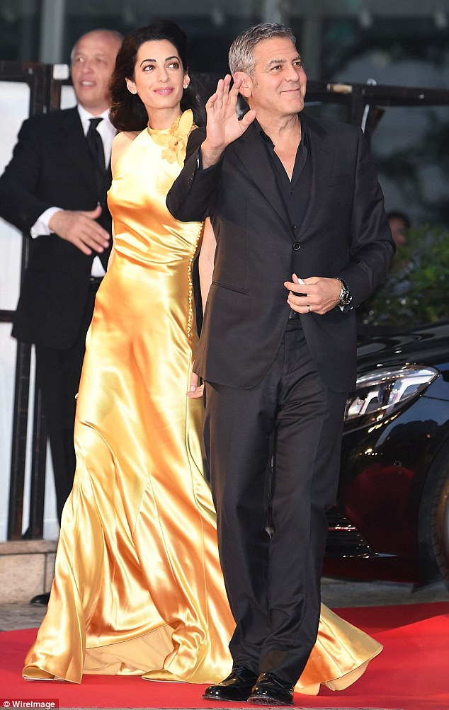 George Clooney at the Tokyo Tomorrowland Premiere 25th May 2015 290EC47E00000578-3096100-The_power_couple_George_Clooney_and_his_wife_Amal_were_pictured_-m-70_1432554729771