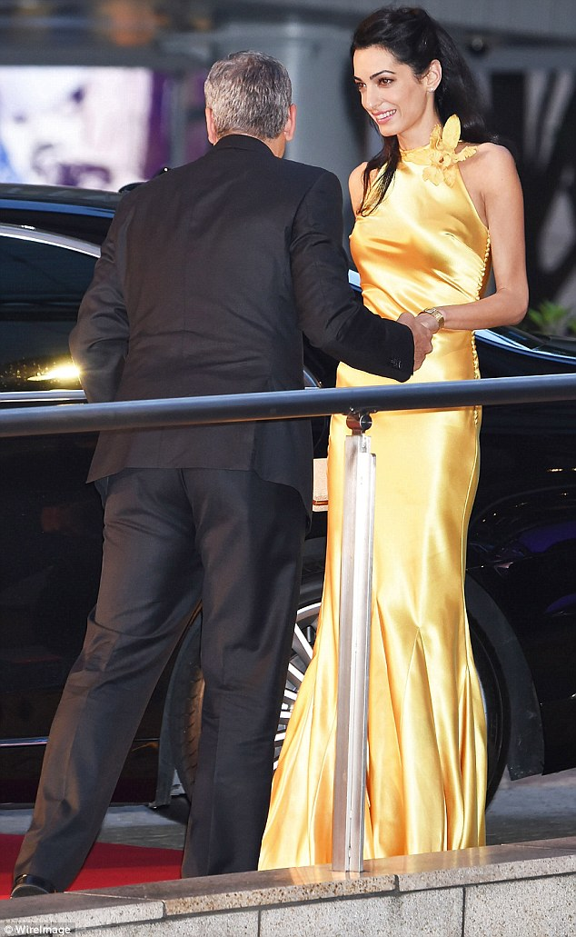 George Clooney at the Tokyo Tomorrowland Premiere 25th May 2015 290EC4A000000578-3096100-Mellow_yellow_His_barrister_wife_looked_incredible_in_a_satin_ha-m-71_1432554739871