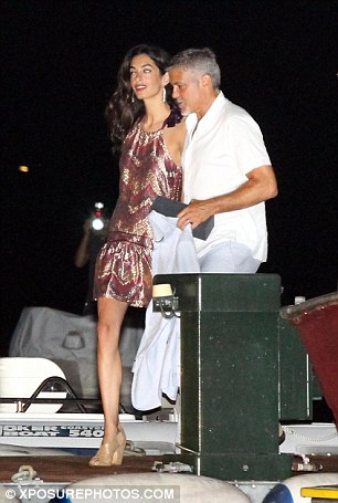George Clooney & Amal in Como celebrating 4th of July with Julia Roberts 2A3D16B100000578-3149837-Summer_dress_Both_spouses_headed_to_their_boat_while_wearing_lig-a-82_1436077036793
