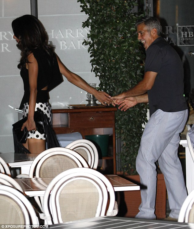 George Clooney has a laughing fit as he steps out for romantic date with his leggy wife Amal in Lake Como - 23. July 2015 2AC3340A00000578-3171508-image-a-133_1437610302001