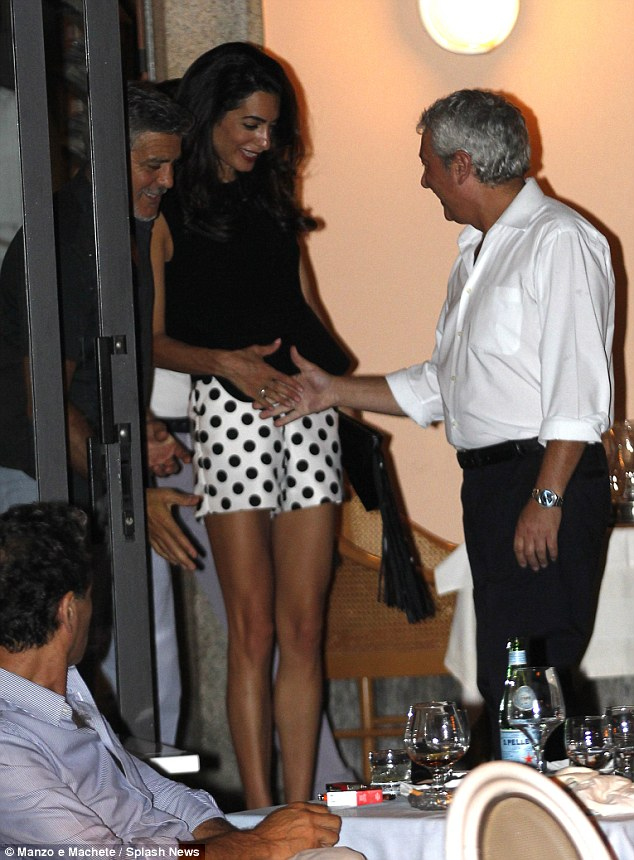 George Clooney has a laughing fit as he steps out for romantic date with his leggy wife Amal in Lake Como - 23. July 2015 2AC339D100000578-3171508-image-m-128_1437610249299