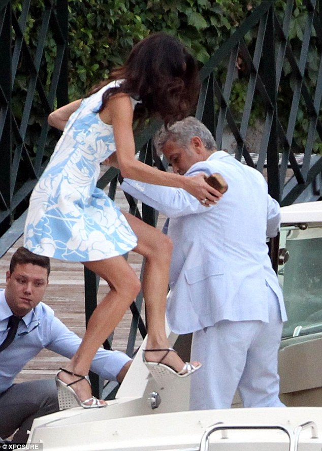 George and Amal Clooney look smitten as they don matching blue hues for date night in Lake Como July 24, 2015 - Page 2 2ACC719E00000578-3174051-image-a-61_1437784493948