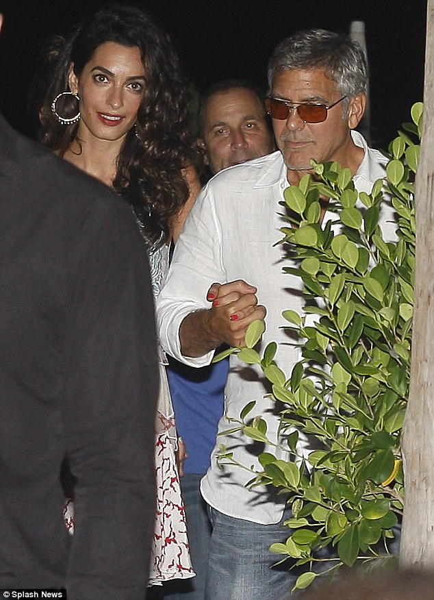 George Clooney, Amal, Rande and Cindy Gerber at the Es Torrent restaurant in Ibiza 22. August 2015 2B969F2100000578-3207554-image-m-49_1440297399714