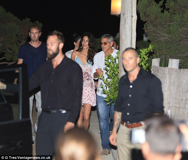 George Clooney, Amal, Rande and Cindy Gerber at the Es Torrent restaurant in Ibiza 22. August 2015 2B98119700000578-3207554-image-m-52_1440322308804