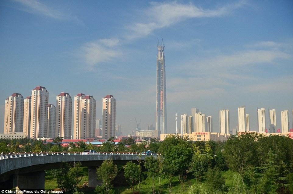 Die Zahlen 711/117 und 911/119 2C1197C000000578-3229351-China_117_Tower_pictured_centre_also_known_as_Goldin_Finance_117-a-68_1441900690497