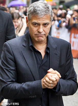 George Clooney at Toronto film festival 11th September 2015 2C33CBA200000578-3231561-image-a-54_1442018037917