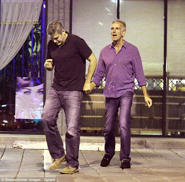George Clooney and his friend out for dinner at Kazu Sushi in Studio City with his Corvette 17. Sept 2015  2C8BC73500000578-3242339-image-a-41_1442773785887