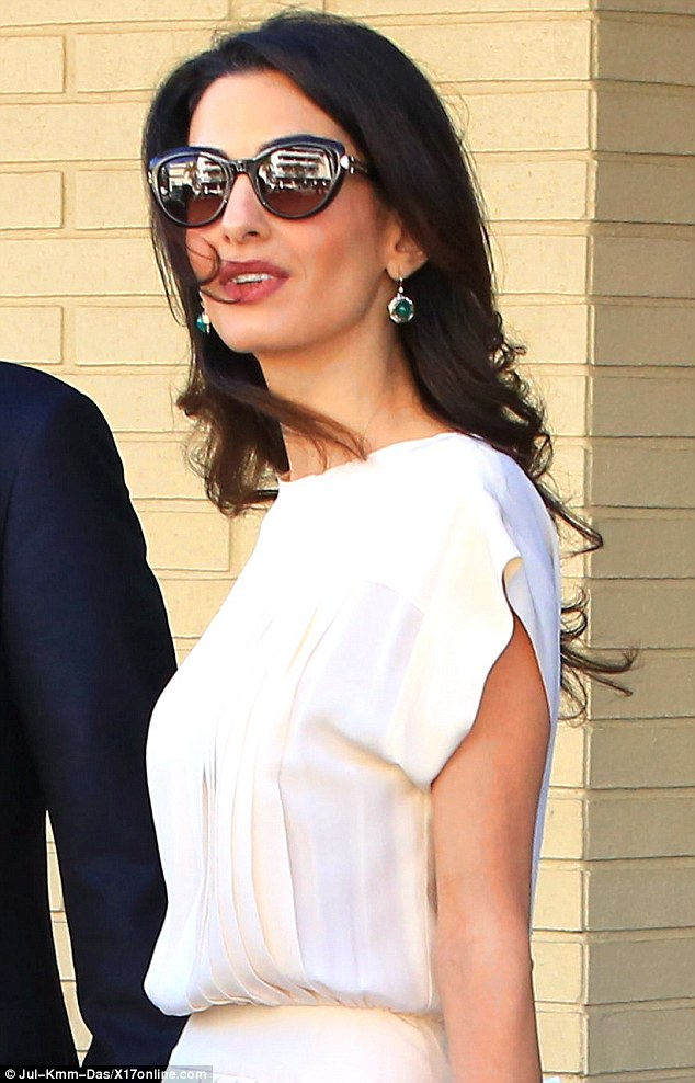 George and Amal lunch with David Milliband in Beverley Hills Oct 22 2015 2DAE15D300000578-3285555-She_gets_it_right_every_time_The_brunette_attorney_had_on_an_ivo-m-132_1445561282427