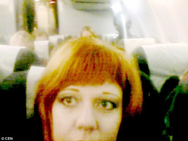 Alien Grey Seen In Russian Woman's Airplane Selfie.  2F7BD4EA00000578-0-image-m-30_1450448129192