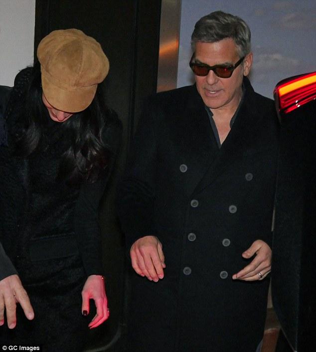 George Clooney & Amal arrive in Berlin 10.02.2016 310F73CF00000578-0-image-m-63_1455128586490