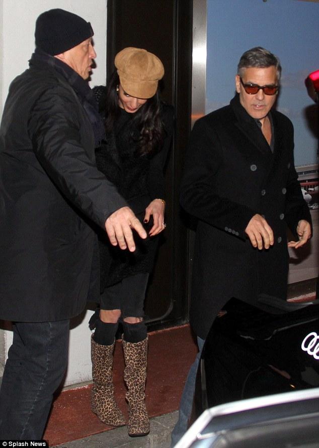 George Clooney & Amal arrive in Berlin 10.02.2016 310F92B600000578-0-image-m-47_1455127922955