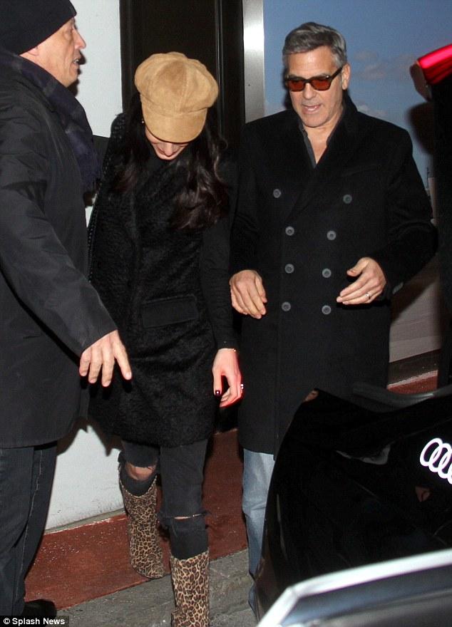 George Clooney & Amal arrive in Berlin 10.02.2016 310F92C200000578-0-image-m-48_1455127967555