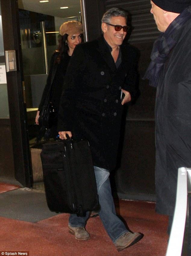 George Clooney & Amal arrive in Berlin 10.02.2016 310F938800000578-0-image-m-61_1455128284261