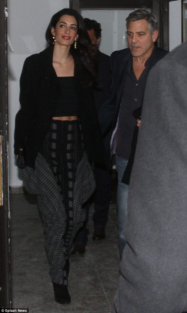 George and Amal Clooney at Grill Royal restaurant in Berlin 10.02.2016 3111FC8F00000578-3441619-image-m-55_1455155354958