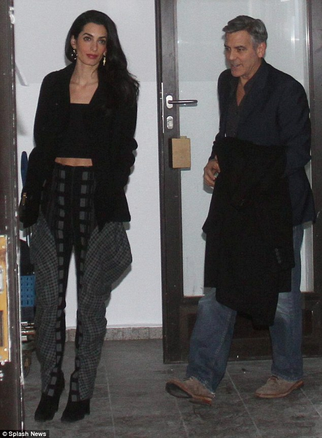 George and Amal Clooney at Grill Royal restaurant in Berlin 10.02.2016 3111FE7300000578-3441619-image-m-38_1455153812075