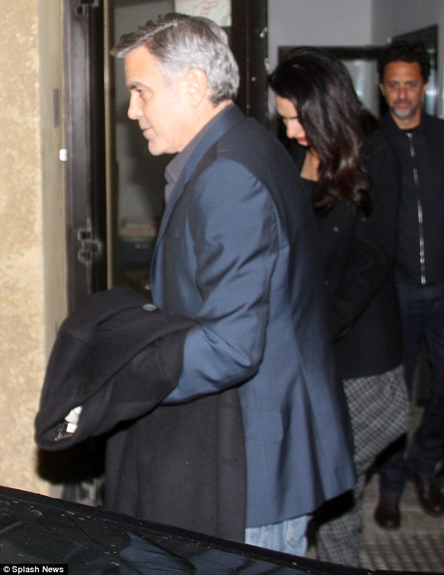 George and Amal Clooney at Grill Royal restaurant in Berlin 10.02.2016 3111FE8300000578-3441619-image-m-56_1455155455428