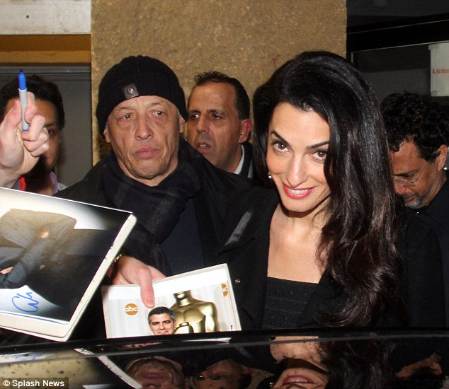 George and Amal Clooney at Grill Royal restaurant in Berlin 10.02.2016 3111FEA700000578-3441619-image-m-50_1455154900109