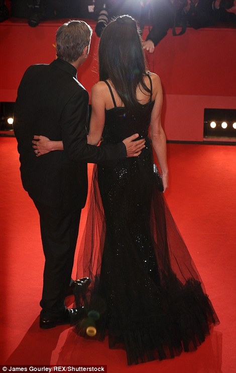 George Clooney and Amal on the red carpet for Hail Caesar Berlin Film Fest premiere 311A4EE100000578-3442938-image-m-160_1455220352145